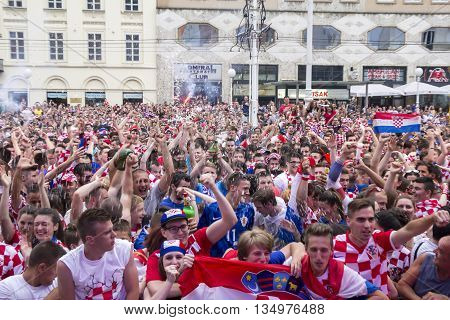 ZAGREB CROATIA - JUNE 17 Croatian football fans on the Ban Jelacic Square watching EURO 2016 match Czech Republic vs Croatia on June 17 2016 in Zagreb Croatia