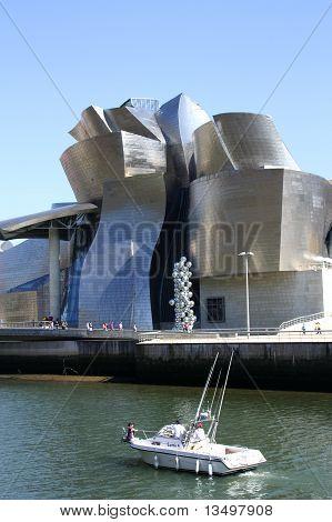 Motor Boat Past The Guggenheim Museum