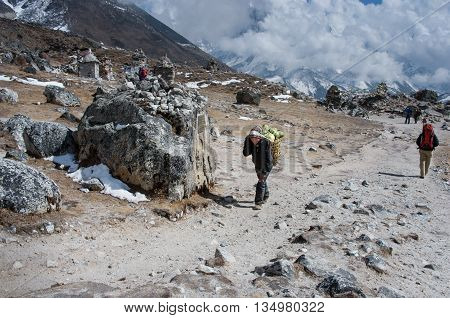 Porters Carry Heavy Load , Nepal