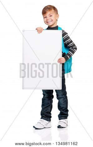 Full length portrait of a schoolboy presenting blank board, isolated on white background