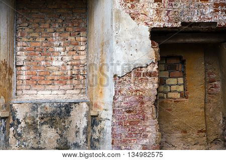 different structures and textures of brick masonry and plaster in a ruin lost place background with copy space