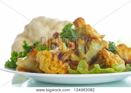 cauliflower baked in batter on a white background