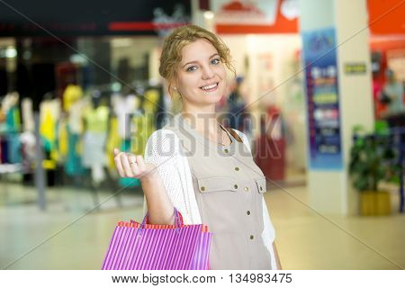Portrait Of Young Happy Woman In Shopping Center