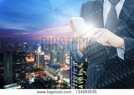 Double exposure of professional businessman using smart phone with servers technology in data center city center of business and world map network connection in IT Business concept world map from NASA