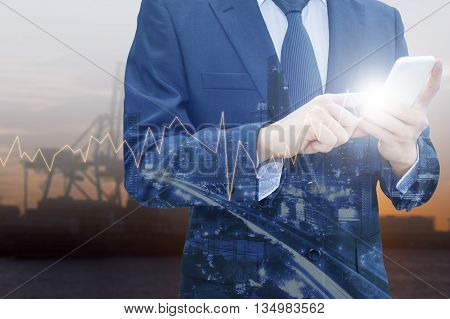Double exposure of professional businessman using smart phone and city centre of business with blurred transportation port background Technology Transportation & Business trading concept