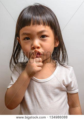 Little girl with gesture in studio shot