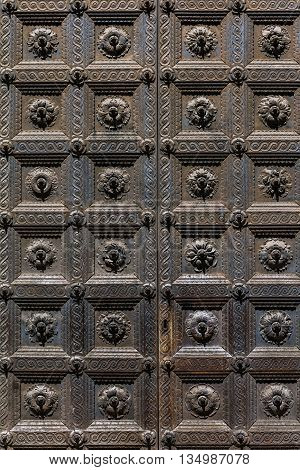 Medieval door of the Baptistery of Parma in Parma Italy