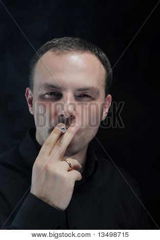 young man smokes a cigarette