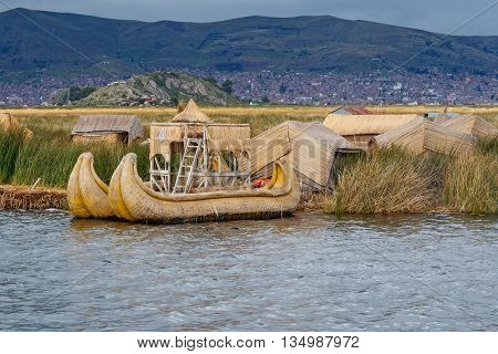 Traditional village on floating Uros islands on lake Titicaca in Peru South America