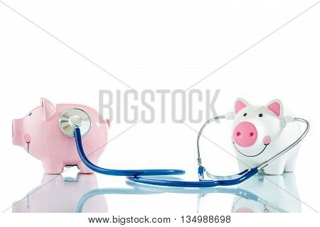 Stethoscope And Two Piggy Bank