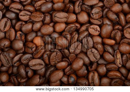 Close up of roasted coffe beans as bacgroung