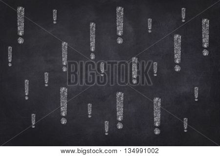 many exclamation marks on chalkboard background concept