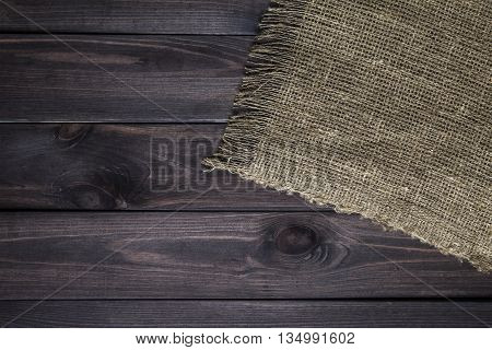 Hessian texture on wooden table background. Wooden table with sacking