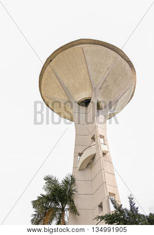 Old style of water tank to reserve water for emergency using which isolated on white background. Tank has spiral ladder build-in for walking up from ground.