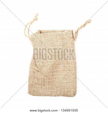 Tiny sackcloth bag with a tie string isolated over the white background