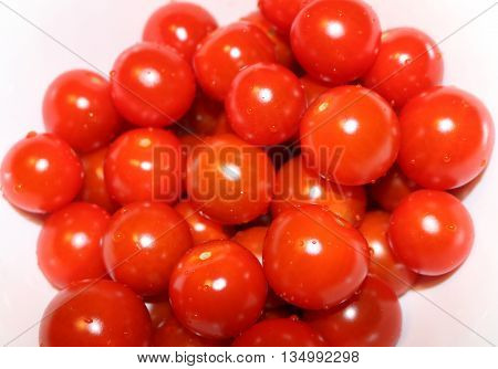red cherry tomatoes with water drops. texture
