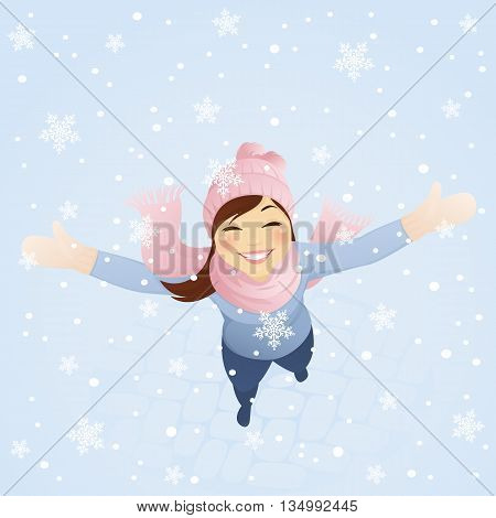 Cheerful girl is looking up at snowflakes