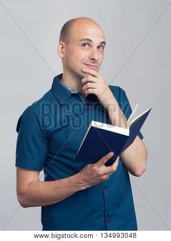 Daydreaming Bald Man Reads A Book