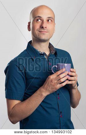 Handsome Bald Man Drinks A Coffee Or Tea