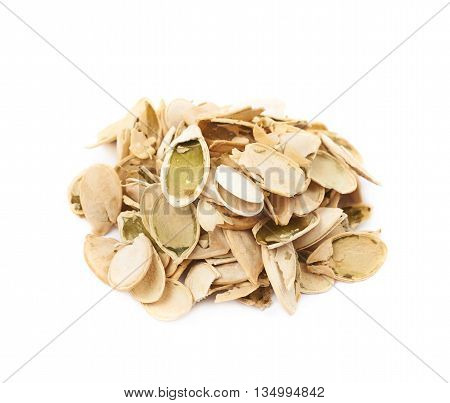 Pile of pumpkin seeds shells isolated over the white background