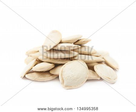 Pile of pumpkin seeds isolated over the white background