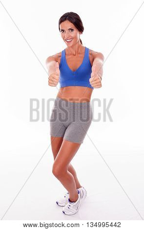 Smiling Brunette Gesturing With Her Thumbs