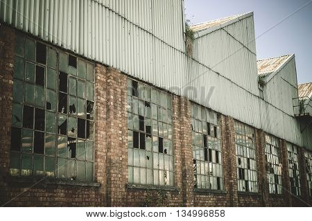 Very old abandoned warehouse in steel industry. Retro tone