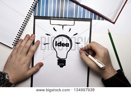 human hands and idea icon on a paper close up