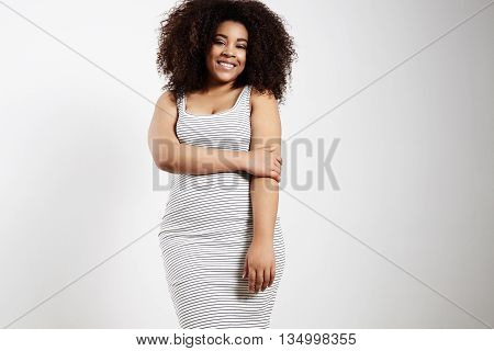 pretty shy plus size model in a studio shoot