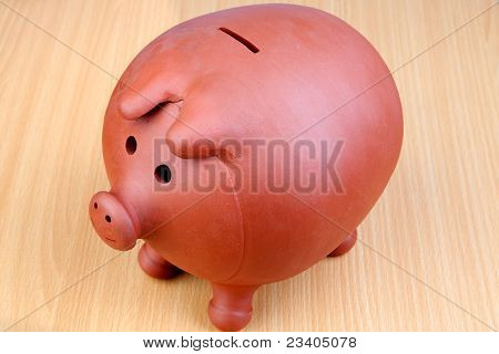 Piggy-bank On A Wooden Table