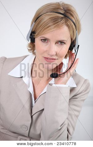Smart woman wearing a telecommunications headset