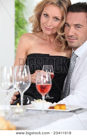Happy couple enjoying romantic meal