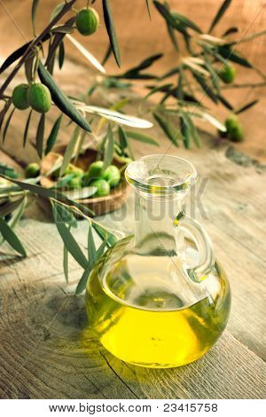 Extra virgin healthy Olive oil with fresh olives