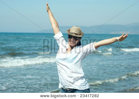 Happy Woman With Hands In The Air