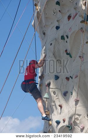 Climber On Rock Climbing Wall