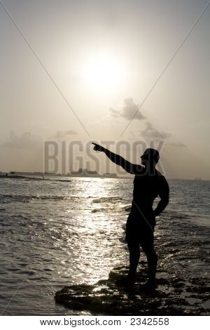 Silhouette Of Man Pointing