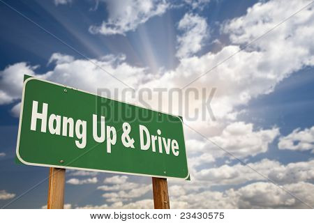 Hang Up and Drive Green Road Sign with Dramatic Sky, Clouds and Sun.