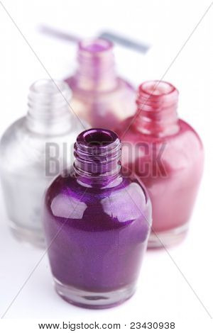 closeup of different shades of nail polish, shallow dof