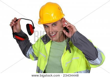 Worker holding hearing protection