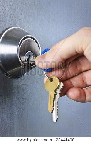 Hand Inserting Keys In Lock
