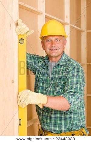 Handyman Mature Professional With Spirit Level