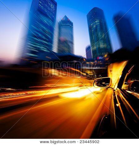 speeding car through the street of shanghai china in night.
