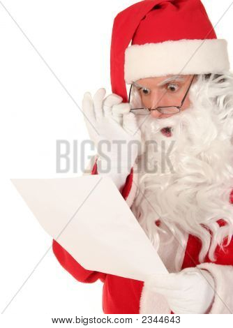 Picture or Photo of Santa reading a letter with a shocked expression