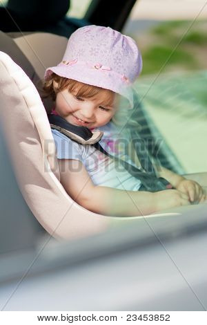 Little Girl In Safety Seat