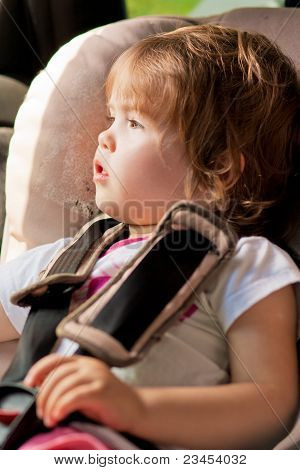 Little Cute Kid In Car Safety Seat