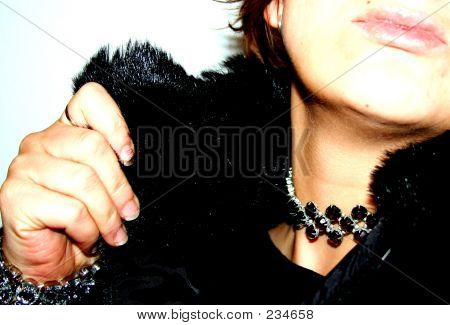 Middle-aged Woman In Fur With Jewelry And An Attitude