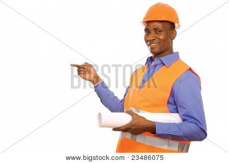Happy young afro-american engineer  with blueprints pointing at something isolated on white