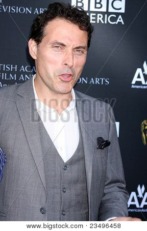 LOS ANGELES - SEP 17:  Rufus Sewell arrives at the 9th Annual BAFTA Los Angeles TV Tea Party. at L'Ermitage Beverly Hills Hotel on September 17, 2011 in Beverly Hills, CA