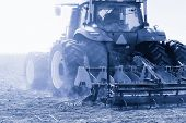 Modern Combine Harvester Works In The Field. Sowing And Harvesting. The Concept Of Agronomy. poster