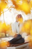 picture of blonde woman  - Portrait of beautiful young woman walking outdoors in autumn - JPG